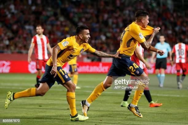 Atletico de Madrid's Uruguayan defender Jose Gimenez celebrates Atletico de Madrid's Argentinian forward Angel Correa after scoring during the...