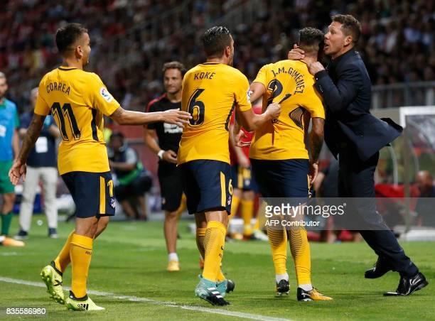 Atletico de Madrid's Uruguayan defender Jose Gimenez celebrates with Atletico de Madrid's Argentinian coach Diego Simeone after scoring during the...