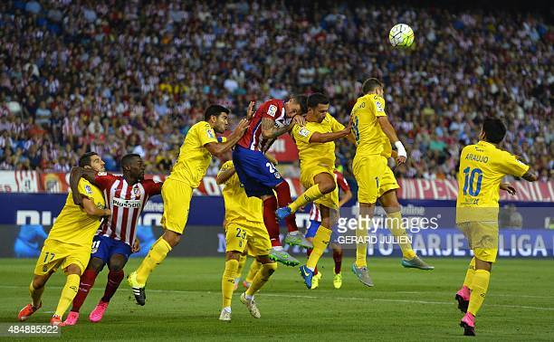 Atletico Madrid and Las Palmas players jump for the ball during the Spanish league football match Club Atletico de Madrid vs UD Las Palmas at the...