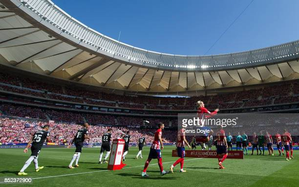 Atletico Madrid and Sevilla players take to the field for the start of the La Liga match between Atletico Madrid and Sevilla at Wanda Metropolitano...