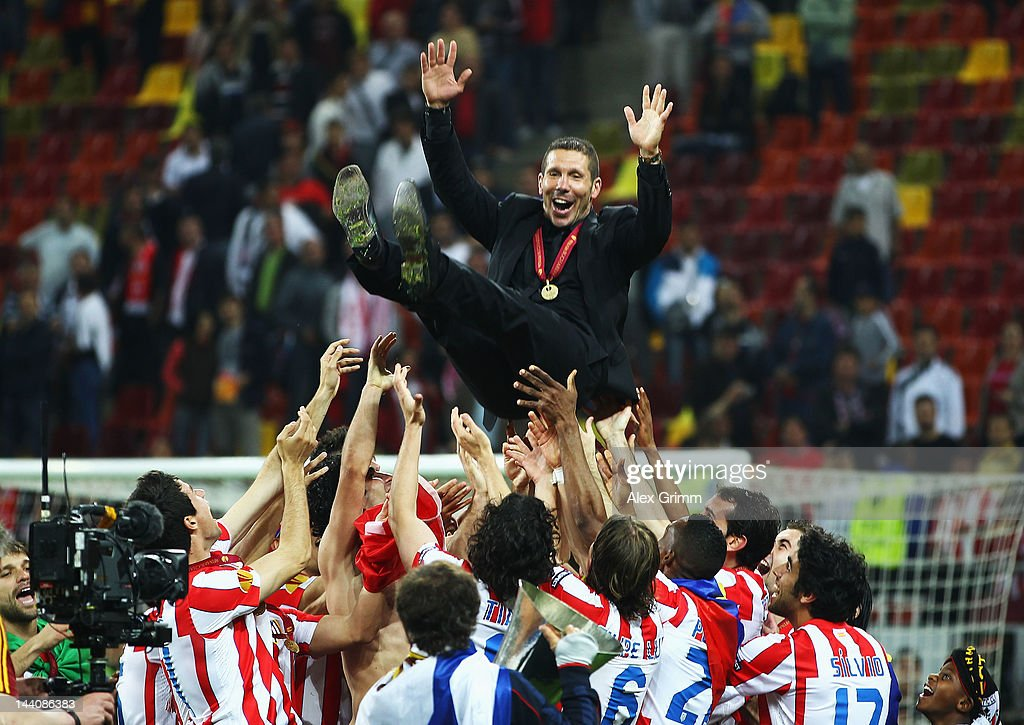 Atletico Madrid Coach <a gi-track='captionPersonalityLinkClicked' href=/galleries/search?phrase=Diego+Simeone&family=editorial&specificpeople=226872 ng-click='$event.stopPropagation()'>Diego Simeone</a> is thrown in the air by his players following their victory at the end of the UEFA Europa League Final between Atletico Madrid and Athletic Bilbao at the National Arena on May 9, 2012 in Bucharest, Romania.
