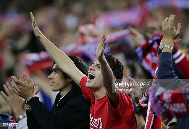 Atletico Madrid fans celebrate after their team beat FC Barcelona 21 in a Primera Liga soccer match at the Calderon September 18 in Madrid Spain