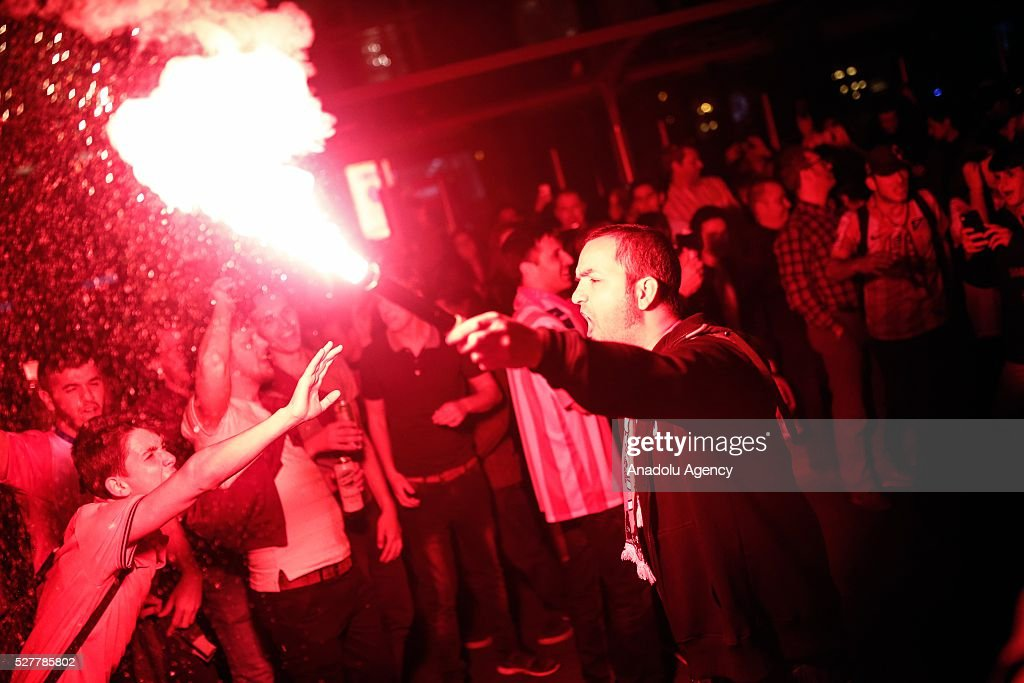 Atletico Madrid fans celebrate the victory after winning the UEFA Champions League semifinal second leg soccer match between FC Bayern Munich and Atletico Madrid, at Neptune square in Madrid, Spain on May 4, 2016.