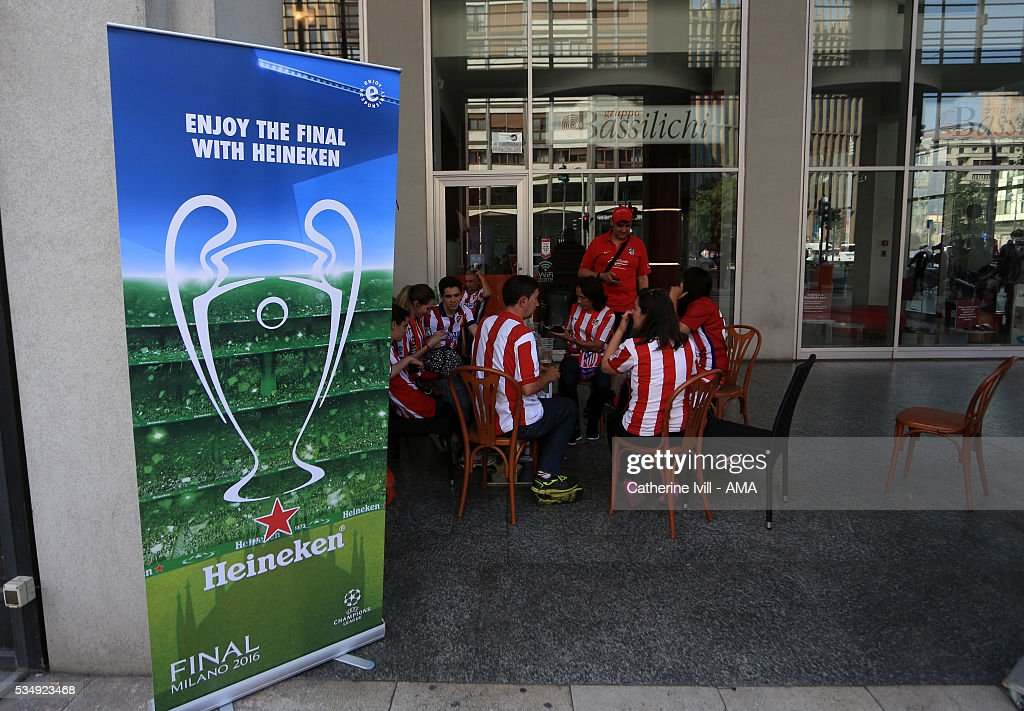 Atletico Madrid fans next to a Heineken advertisement saying enjoy the final ahead of the UEFA Champions League Final match between Real Madrid and Club Atletico de Madrid at Stadio Giuseppe Meazza on May 28, 2016 in Milan, Italy. (Photo by Catherine Ivill - AMA/Getty Images