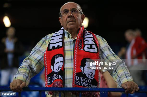 Atletico Madrid fans with Atletico Madrid Manager Diego Simeone scarf