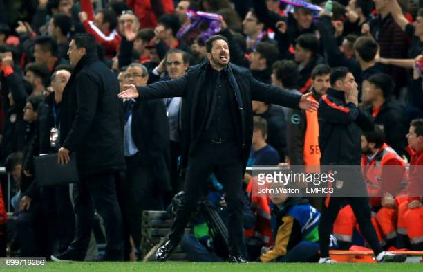 Atletico Madrid manager Diego Simeone gestures from the touchline towards the end of the match