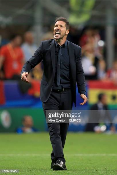 Atletico Madrid manager Diego Simeone gestures to the fans before the penalty shootout