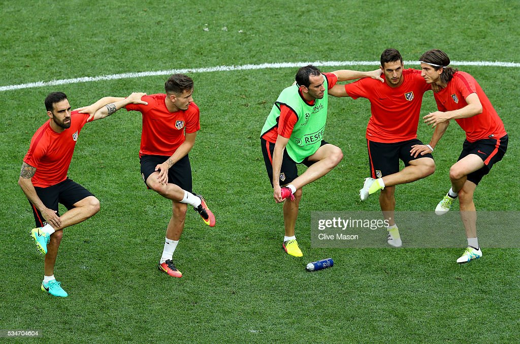 Atletico Madrid player stretch during an Atletico de Madrid training session on the eve of the UEFA Champions League Final against Real Madrid at Stadio Giuseppe Meazza on May 27, 2016 in Milan, Italy.