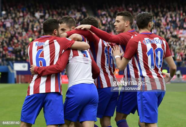 Atletico Madrid players celebrate a goal during the Spanish league football match Club Atletico de Madrid vs Valencia CF at the Vicente Calderon...