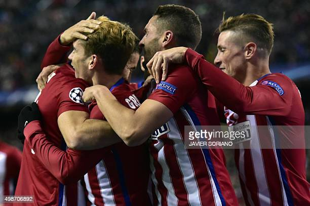 Atletico Madrid players celebrate a goal during the UEFA Champions League Group C football match Club Atletico de Madrid vs Galatasaray AS at the...