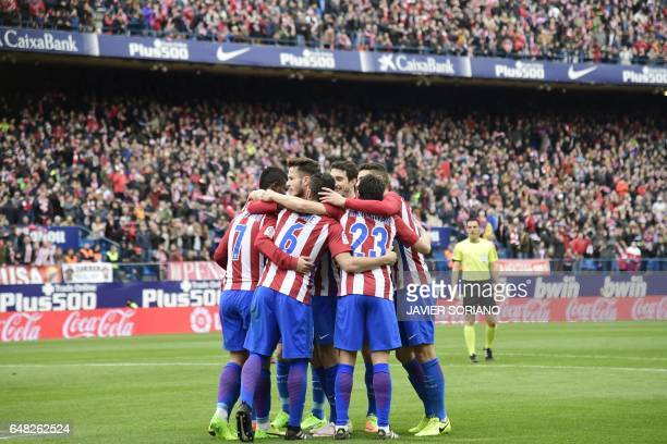 Atletico Madrid players celebrate after scoring a goal during the Spanish league football match Club Atletico de Madrid vs Valencia CF at the Vicente...
