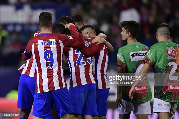 Atletico Madrid players celebrate after scoring during the Spanish Copa del Rey round of 32 second leg football match Club Atletico de Madrid vs CD...