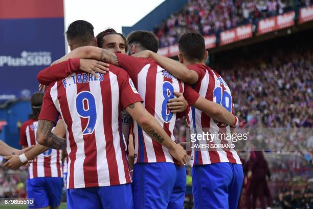 Atletico Madrid players celebrate after scoring during the Spanish league football match Club Atletico de Madrid vs SD Eibar at the Vicente Calderon...