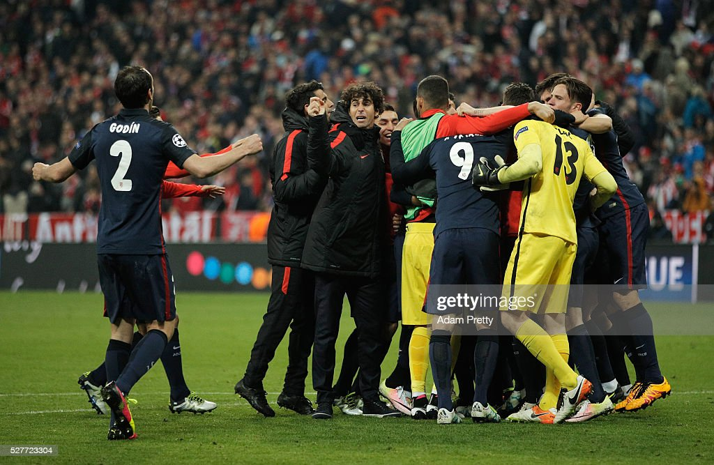 Atletico Madrid players celebrate after the UEFA Champions League semi final second leg match between FC Bayern Muenchen and Club Atletico de Madrid at Allianz Arena on May 3, 2016 in Munich, Germany. Bayern Munich won the match 2-1, but Atletico Madrid reached the final on the away goals rule.