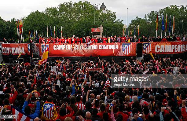 Atletico Madrid players celebrate with their fans at the Neptuno fountain in Madrid the day after Atletico won the UEFA Europa League Cup final on...