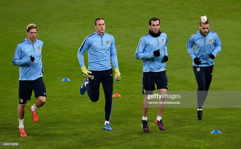 Atletico Madrid players practice during a press conference ahead of their UEFA Champions League Round of 16 first leg match against Bayer Leverkusen on February 24, 2015 in Leverkusen, Germany.