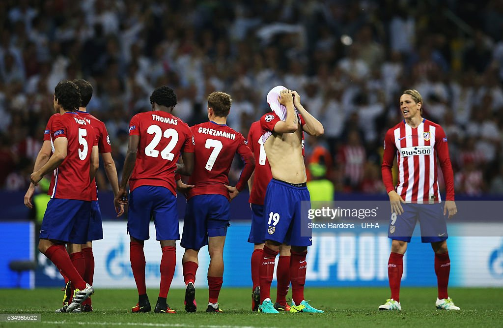 Atletico Madrid players show their dejection after their defeat through the penalty shootout in the UEFA Champions League Final between Real Madrid and Club Atletico de Madrid at Stadio Giuseppe Meazza on May 28, 2016 in Milan, Italy..
