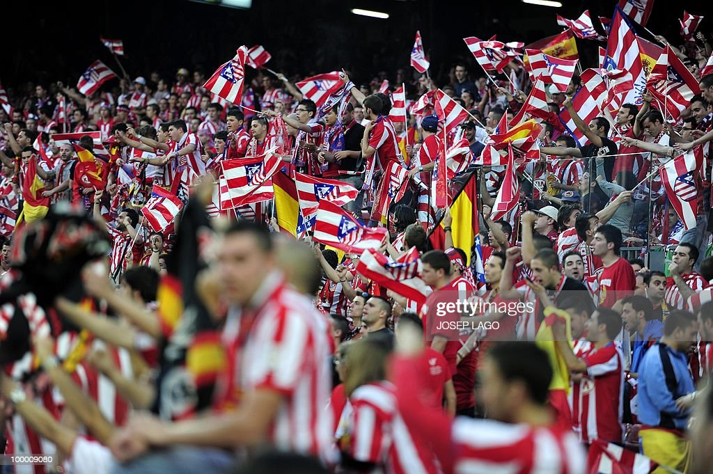 Atletico Madrid supporters cheer their team before the King's Cup final match Sevilla against Atletico Madrid at the Camp Nou stadium in Barcelona on May 19, 2010.