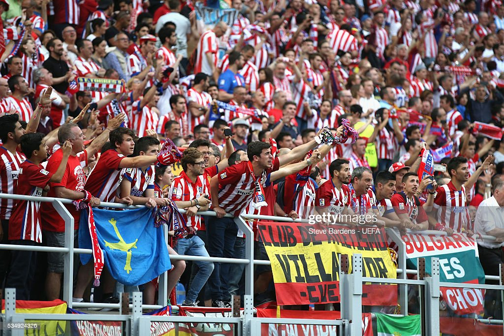 Atletico Madrid supporters enjoy the atmosphere prior to at the stadium prior to the UEFA Champions League Final between Real Madrid and Club Atletico de Madrid at Stadio Giuseppe Meazza on May 28, 2016 in Milan, Italy.
