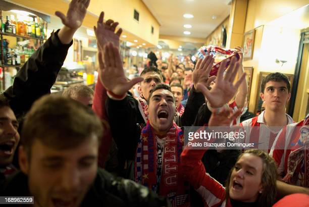 Atletico Madrid supporters react while watching the Copa del Rey Final game between Real Madrid and Atletico de Madrid at a bar on May 17 2013 in...