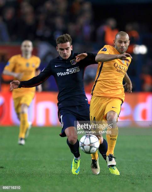 Atletico Madrid's Antoine Griezmann battles for possession of the ball with Barcelona's Javier Mascherano