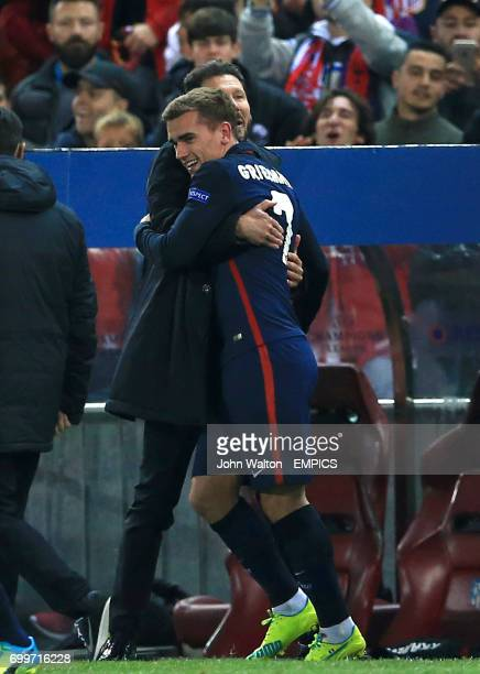 Atletico Madrid's Antoine Griezmann celebrates victory with manager Diego Simeone after the final whistle