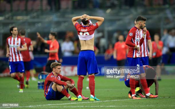 Atletico Madrid's Antoine Griezmann Lucas Hernandez and Yannick Carrasco appear dejected