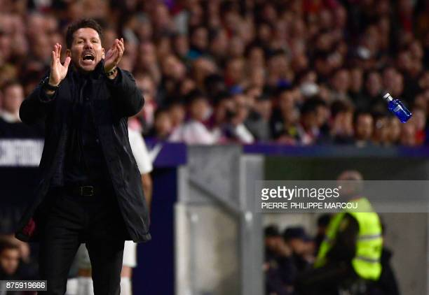 Atletico Madrid's Argentinian coach Diego Simeone applauds during the Spanish league football match Atletico Madrid vs Real Madrid at the Wanda...