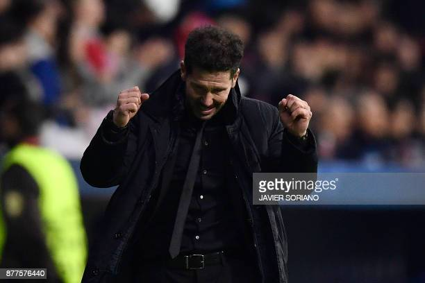 Atletico Madrid's Argentinian coach Diego Simeone celebrates after his team's second goal during the UEFA Champions League group C football match...