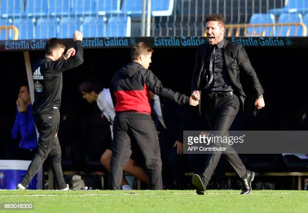 Atletico Madrid's Argentinian coach Diego Simeone celebrates at the end of the Spanish league football match RC Celta de Vigo vs Club Atletico de...