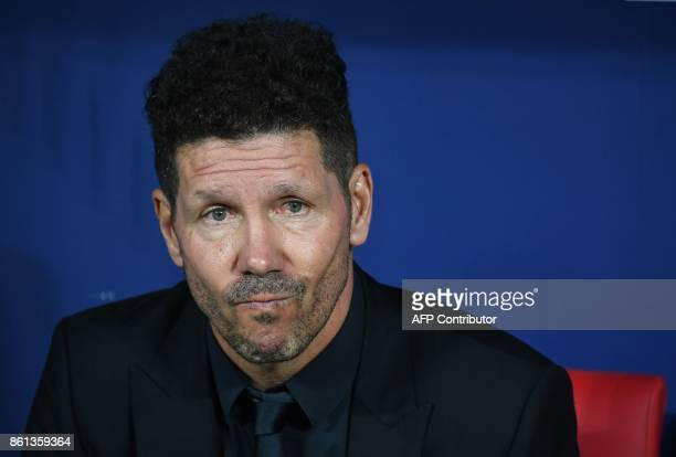 Atletico Madrid's Argentinian coach Diego Simeone gestures before the Spanish league football match Club Atletico de Madrid vs FC Barcelona at the...