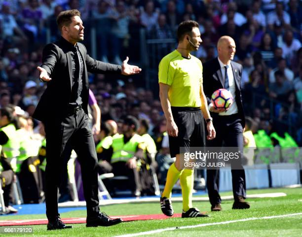 Atletico Madrid's Argentinian coach Diego Simeone gestures close to Real Madrid's French coach Zinedine Zidane during the Spanish league football...