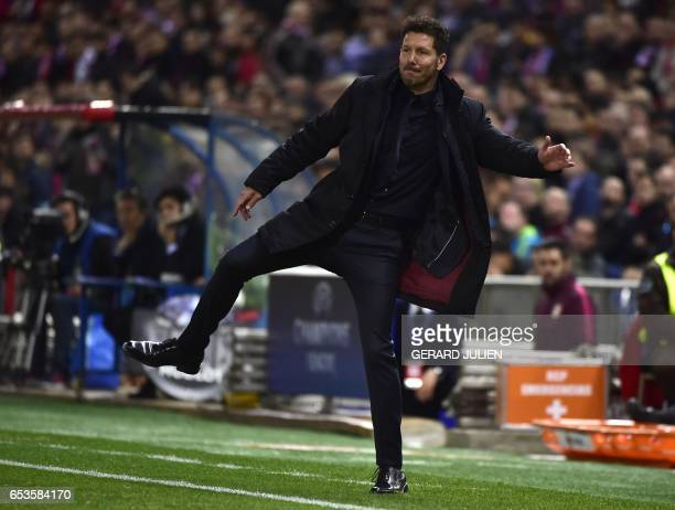 Atletico Madrid's Argentinian coach Diego Simeone gestures during the UEFA Champions League round of 16 second leg football match Club Atletico de...