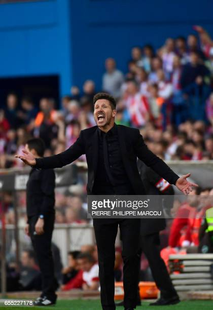 Atletico Madrid's Argentinian coach Diego Simeone gestures during the Spanish league football match Club Atletico de Madrid vs Sevilla FC at the...