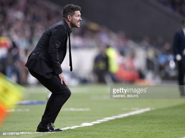 Atletico Madrid's Argentinian coach Diego Simeone gestures during the Spanish league football match Club Atletico de Madrid vs FC Barcelona at the...