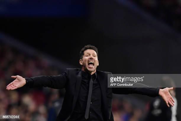 Atletico Madrid's Argentinian coach Diego Simeone gestures during the UEFA Champions League football match Club Atletico de Madrid vs Qarabag FK at...