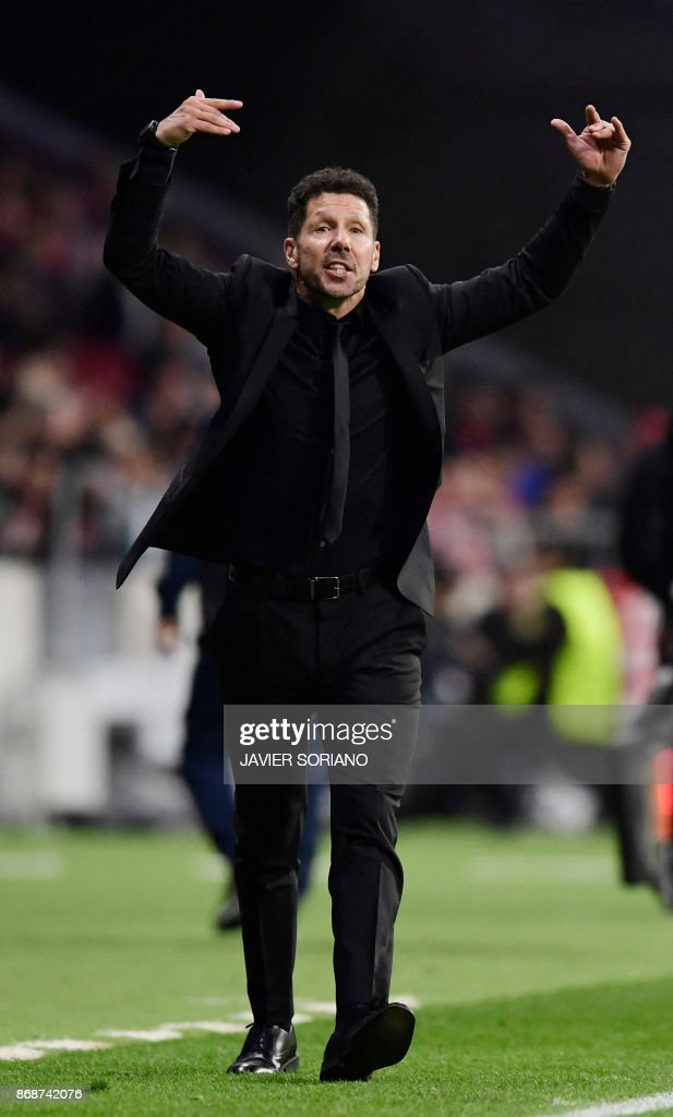 Atletico Madrid's Argentinian coach Diego Simeone gestures during the UEFA Champions League football match Club Atletico de Madrid vs Qarabag FK at the Wanda Metropolitano stadium in Madrid on October 31, 2017. /