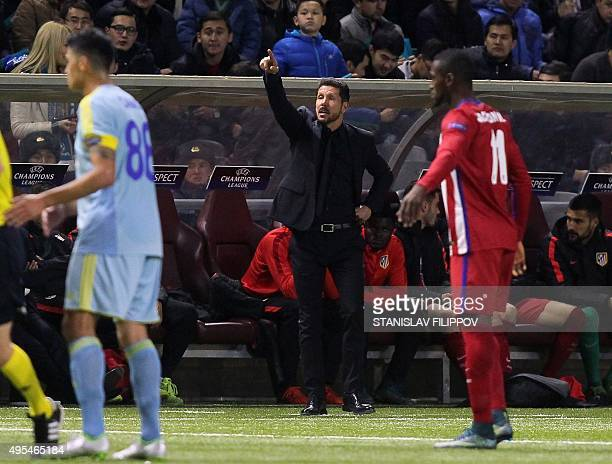 Atletico Madrid's Argentinian coach Diego Simeone gestures from the touchline during the UEFA Champions League group C football match between FC...