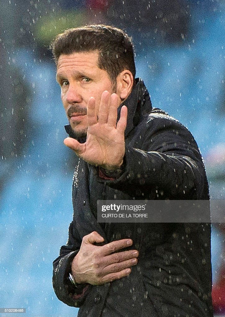 Atletico Madrid's Argentinian coach Diego Simeone gestures from the sideline during the Spanish league football match Getafe CF vs Club Atletico de Madrid at the Coliseum Alfonso Perez stadium in Getafe on February 14, 2016. / AFP / CURTO DE LA TORRE