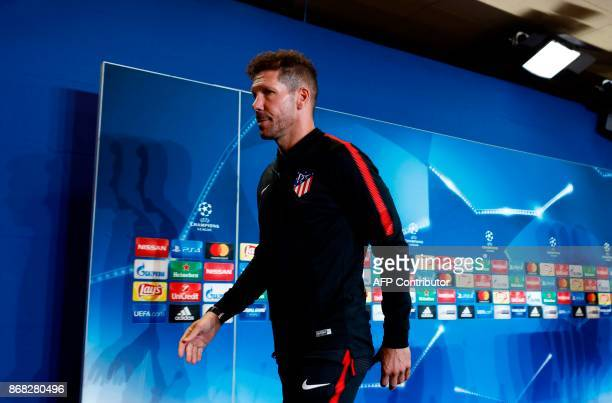Atletico Madrid's Argentinian coach Diego Simeone leaves after a press conference at the Wanda Metropolitano stadium in Madrid on October 30 2017 on...