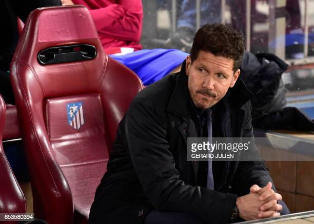 Atletico Madrid's Argentinian coach Diego Simeone looks on before the UEFA Champions League round of 16 second leg football match Club Atletico de...