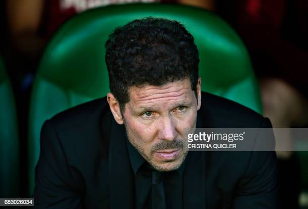 Atletico Madrid's Argentinian coach Diego Simeone looks on before the Spanish league football match Real Betis vs Club Atletico de Madrid at the...