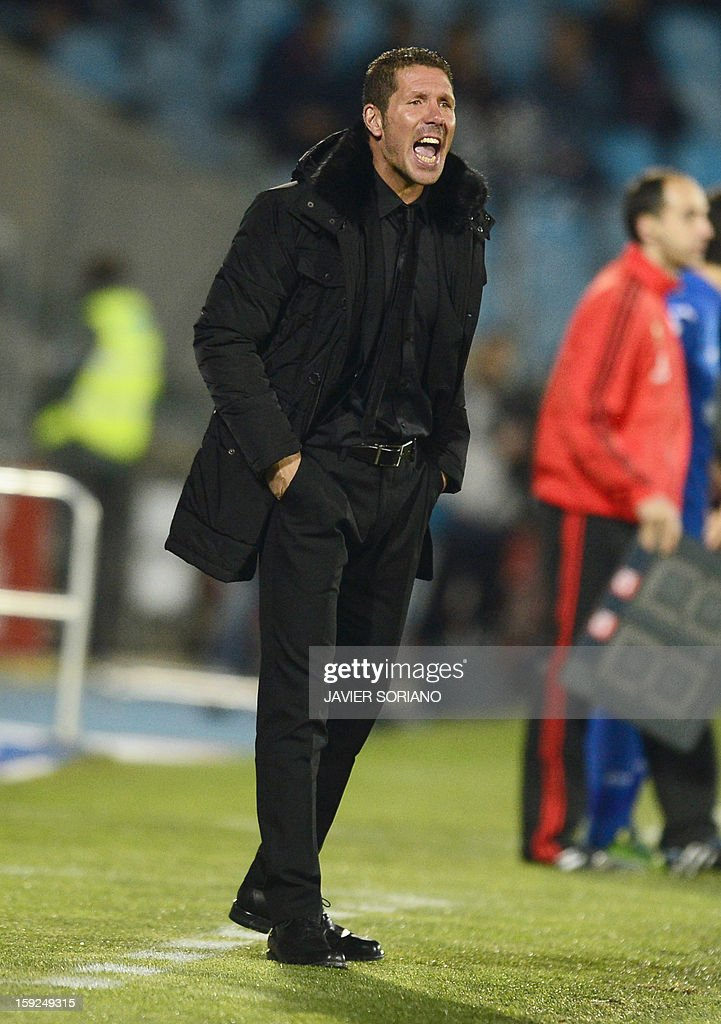 Atletico Madrid's Argentinian coach Diego Simeone reacts during the Spanish Copa del Rey (King's Cup) round of 16, second leg, football match Getafe vs Atletico de Madrid at the Coliseum Alfonso Perez stadium in Getafe on January 10, 2013. AFP PHOTO / JAVIER SORIANO