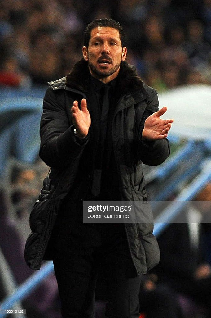 Atletico Madrid's Argentinian coach Diego Simeone reacts during the Spanish league football match Malaga CF vs Atletico de Madrid on March 3, 2013 at Rosaleda stadium in Malaga. AFP PHOTO/ JORGE GUERRERO