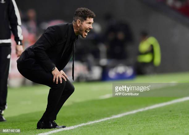 Atletico Madrid's Argentinian coach Diego Simeone shouts instructions to players during the UEFA Champions League football match Club Atletico de...