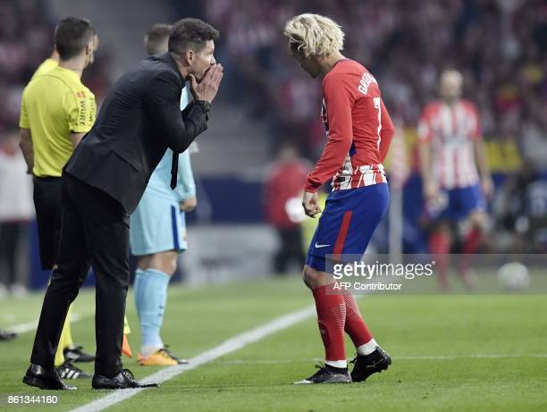 Atletico Madrid's Argentinian coach Diego Simeone talks with Atletico Madrid's French forward Antoine Griezmann during the Spanish league football...