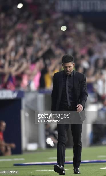Atletico Madrid's Argentinian coach Diego Simeone walks on the sideline during the Spanish league football match Club Atletico de Madrid vs FC...