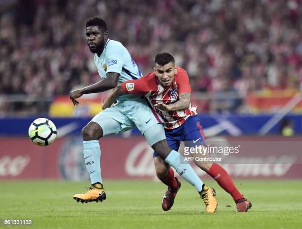 Atletico Madrid's Argentinian forward Angel Correa vies with Barcelona's French defender Samuel Umtiti during the Spanish league football match Club...
