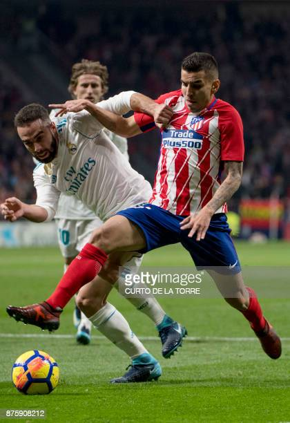 Atletico Madrid's Argentinian forward Angel Correa vies with Real Madrid's Spanish defender Dani Carvajal during the Spanish league football match...