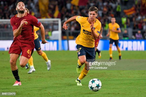 Atletico Madrid's Argentinian forward Luciano Vietto outruns Roma's Greek defender Konstantinos Manolas during the UEFA Champions League Group C...